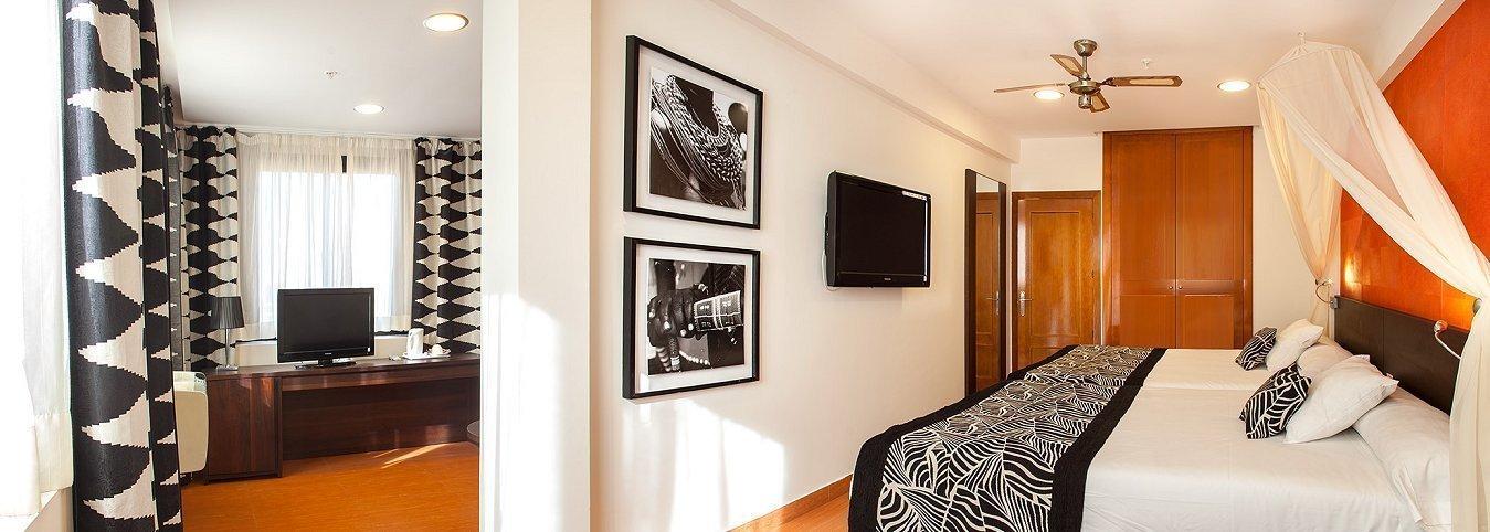 Habitación con salón tematizado Hôtel Magic Aqua™ Rock Gardens